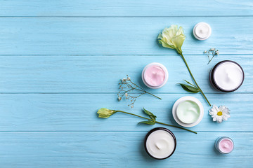Composition with body cream on wooden background