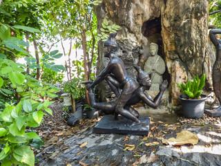 Bangkok, Thailand - Circa January 2018: Statues depicting a Thai Massage (Nuad Boran) move at the famous Wat Pho (Buddhist Temple)