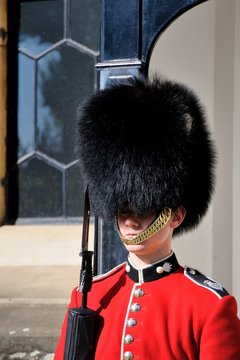 Royal Guard in Tower of London. British Guards in red uniform are the sign of London.