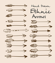 Set of ethnic arrows hand-drawn on a beige background for your design.