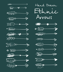 Collection of ethnic arrows hand-drawn on a green background for your design.