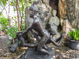 Bangkok, Thailand - Circa January 2018: Statues depicting a Thai Massage (Nuad Boran) move at the famous Wat Pho (Buddhist Temple)