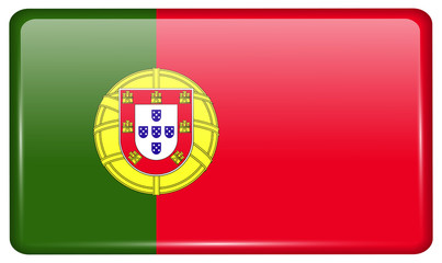 Flags Portugal in the form of a magnet on refrigerator with reflections light.