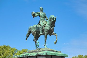 Equestrian statue of William II of the Netherlands on the Buitenhof square in The Hague. The statue was erected in 1924. This is a replica of the statue in Luxembourg from 1884. Wall mural