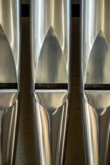 Three organ pipes, closeup.