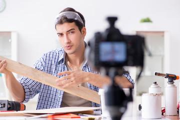 DIY blogger recording video of woorworking hobby
