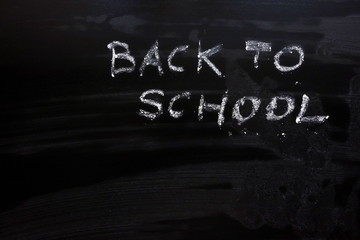 Text back to school on chalkboard, education background concept, copy space for your design