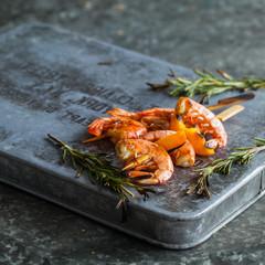 Grilled shrimps. Shrimps skewers, fresh herbs rosemary. copyspace
