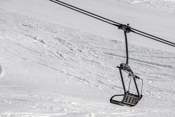Chair Lift for skiers in winter snow dolomites background