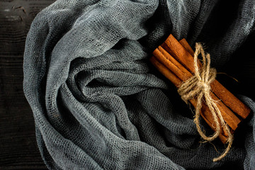 Cinnamon, against a dark background with a napkin, tied up by a string