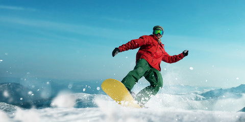 Snowboarder makes a jump, sportsman in action