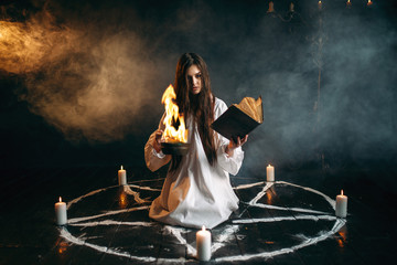 Witch in pentagram circle, dark magic ritual