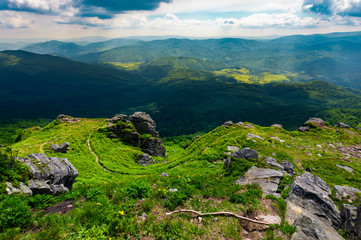 path to a tiger face cliff above the valley. spectacular landscape of Carpathian mountains in summertime. location Pikui mountain, Ukraine