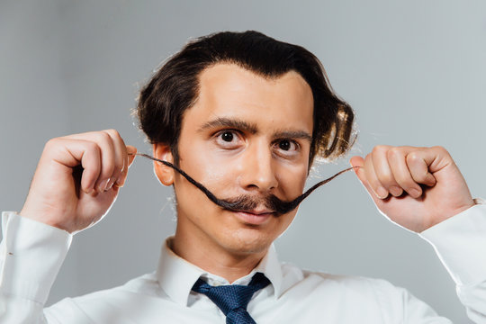eccentric man with a long mustache in his shirt and tie. A mad office worker, a businessman
