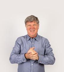 portrait of positive looking mature man in studio