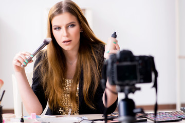 Beauty blogger filing video for her blog or vlog