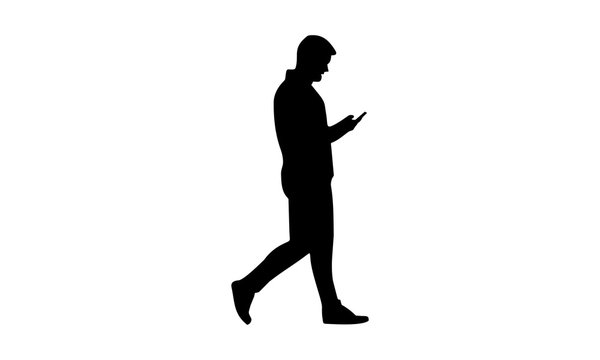 silhouette man walking while holding the phone