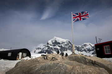 Aluminium Prints Antarctica A British flag flies over Port Lockroy Antarctica home to the southernmost post office on Earth. This research station is known as the Penguin Post Office because of a colony of Gentoo penguins there.