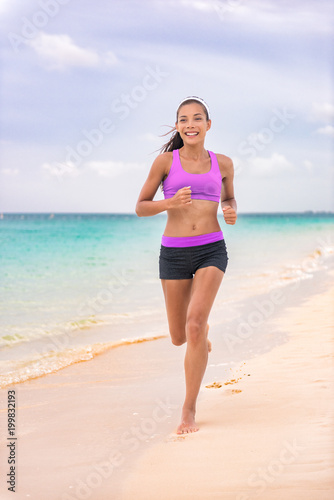 546c793e7ecf Running jogging woman on beach at Caribbean travel vacation living a  healthy lifestyle in sportswear sports