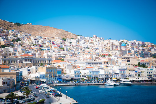 Ermoupoli, Syros - Greece.  View of Syros port with beautiful buildings and houses in a summer day.