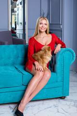 Pretty stylish blonde woman in red dress