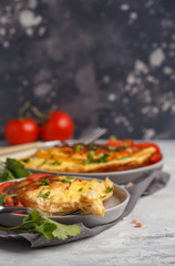 Delicious bright egg omelet with cheese and vegetables. Breakfast food concept, dark background