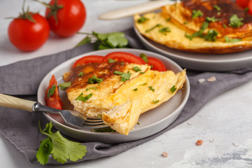 Delicious bright egg omelet with cheese and vegetables. Breakfast food concept, white background