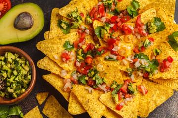Mexican food concept. Nachos - yellow corn totopos chips with guacamole and pico del gallo, top view
