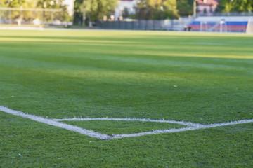 Corner of soccer field, pattern of green grass for football sport, football field, stadium, sport texture, selective focus