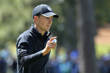 Jordan Spieth of the U.S. raises his ball after making par on the 7th hole during final round play of the 2018 Masters golf tournament in Augusta