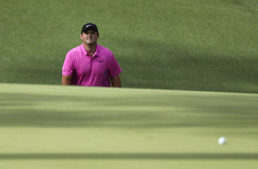 Patrick Reed of the U.S. walks up to his ball on the 10th green during final round play of the 2018 Masters golf tournament in Augusta