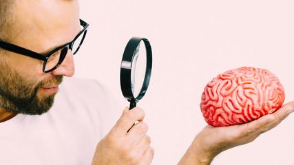 Man looking at human brain