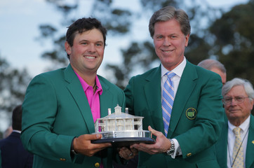 Patrick Reed of the U.S. holds the trophy after winning the 2018 Masters golf tournament in Augusta