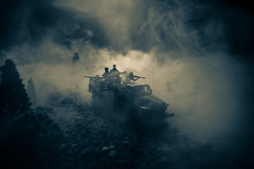 War Concept. Military silhouettes fighting scene on war fog sky background, World War Soldiers Silhouettes Below Cloudy Skyline At night. Attack scene. Selective focus Tanks battle. Decoration