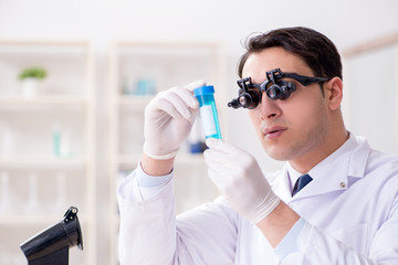 Young chemical scientist working in lab