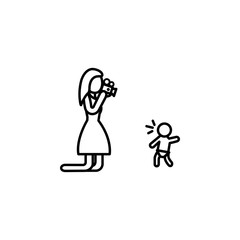 the mother takes the first steps of the child on the camera icon. Element of family for mobile concept and web apps. Thin line  icon for website design and development, app development. Premium icon