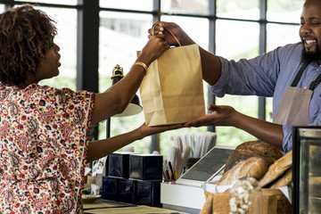Black customer buying bakery products
