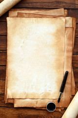 old paper on brown wood texture with pen and ink.