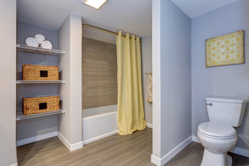 Elegant bathroom with built in shelves.