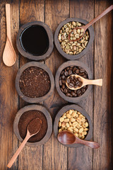 Close up of coffee beans and ground coffee in wooden bowl