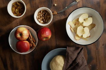 Raw ingredients for cooking apple pie or strudel on wooden table, top view