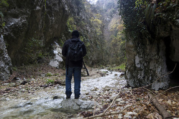hiker in narrow gorge canyon at matese park valle dell'inferno