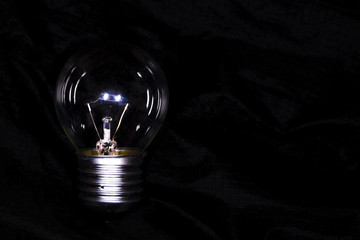 off lamp, in the dark, on a black background with space for text, background image