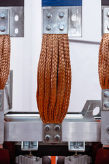 Flexible copper braided high-voltage bus.