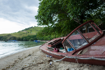Broken boat at beach of Labuan Bajo