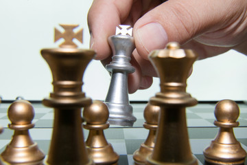gold and silver chess on board close up image abstract Background.