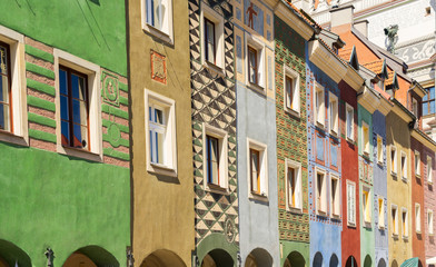 Wall Mural - facades of colorful crooked medieval houses on the central market square in Poznan, Poland
