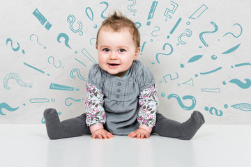 Baby girl being overwhelmed shown by question and exclamation mark graphics around head