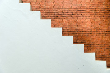 Concrete Staircase with brick wall in residential house building of construction industry