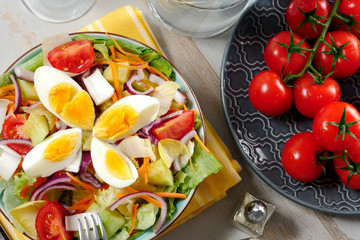 plate of vegetable salad with eggs